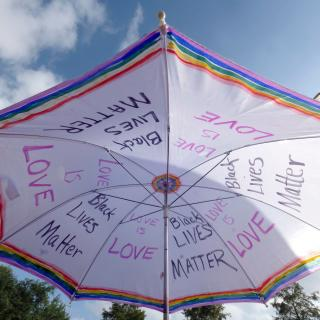 umbrella with BLM and love is love sing