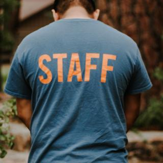 Person with staff shirt