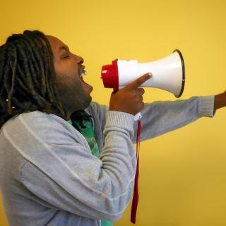 Person yelling into a megaphone