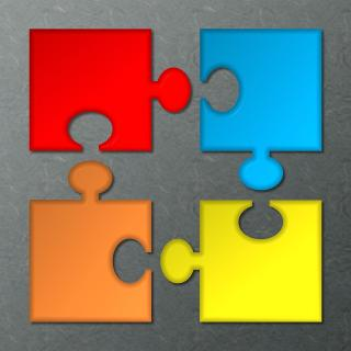 Four colorful puzzle pieces ready to assemble