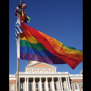 Rainbow flag in front of Massachusetts State House.