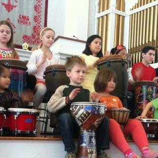 Children drumming at First parish UU Bedford, MA.