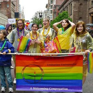 Youth from Bedford, MA march in Boston Pride parade and carry welcoming congregation flag.
