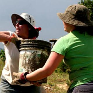 Haiti trip participant Karen Quinlan works to build the eco-village.