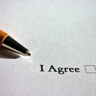 "A pen pointing to the words ""I agree"" with an empty check box."