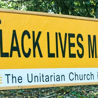 The Black Lives Matter Banner on the road outside our church.