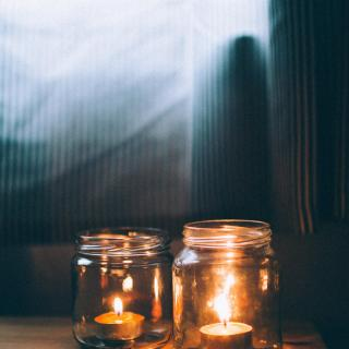 glass jars with candles