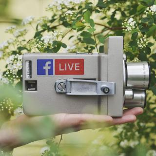 "Vintage movie camera with Facebook logo and the word ""live"" on a decal"