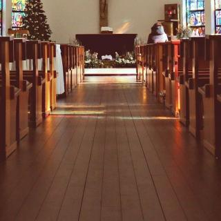 View down the center aisle of a church