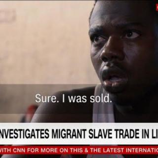 "A subtitle shows an African migrant saying ""Sure. I was sold."" over a chyron reading ""CNN Team Investigates Migrant Slave Trade in Libya"""