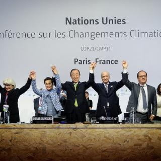 Leaders at the UN COP21 Climate Change Conference celebrate the Paris Agreement's adoption