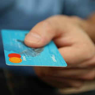 Person holding a debit card
