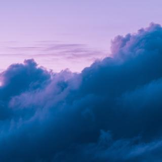 A lavender sky and surreal blue-purple clouds