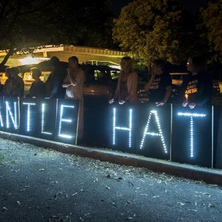 "Large panels with letters in lights: ""Dismantle Hate"""