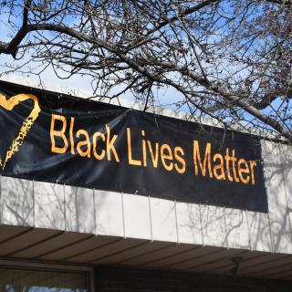 Black Lives Matter banner with Standing on the Side of Love heart at UUCGV, Grand Junction