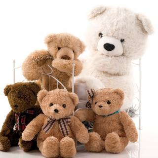 An assortment of teddy bears of different colors and sizes in a doll bed