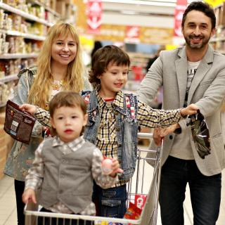 Family of four in a grocery store