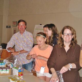 Service project making snack packs at the Central Unitarian Church of Paramus, NJ.