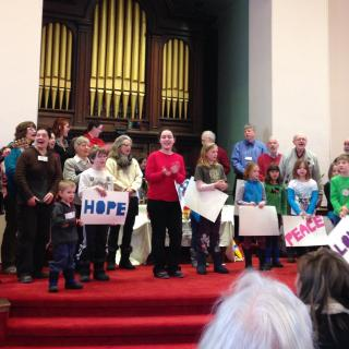 Congregation members sing at Multigenerational Worship at the UU Church of Montpelier VT.