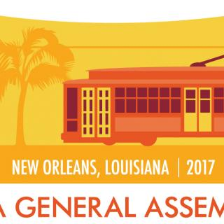 A red trolly against a yellow background, GA 2017 New Orleans