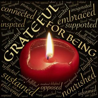 candle surrouned by Grateful for being and other words of gratitude