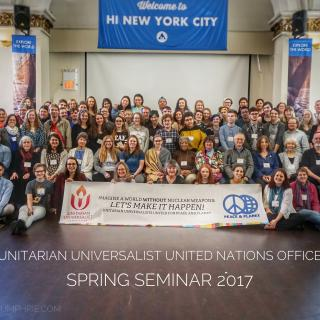 "Group picture of participants at the 2017 Spring Seminar with a sign reading ""Imagine a world without nuclear weapons - let's make it happen! Unitarian Universalists United for Peace and Planet"""