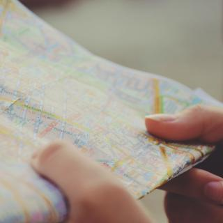 A person's hands hold a folded city map