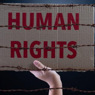 Sign that says Human Rights behind barbed wire