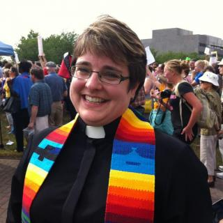 Rev. Lisa Bovee-Kemper in clergy collar and stole (smiling big)