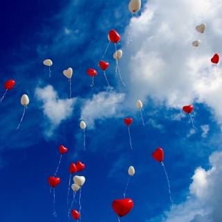 Heart shaped balloons floating in the sky
