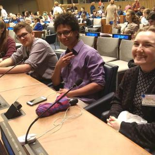 Four youth leaders at the 2016 UU-UNO Intergenerational Spring Seminar Theme Panel at UN Headquarters.