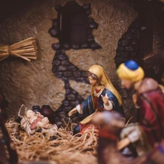 A close-up of a nativity creche, with the Holy Family figures and baby Jesus