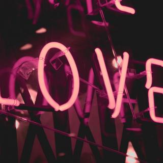 "The word ""LOVE"" in pink neon letters."