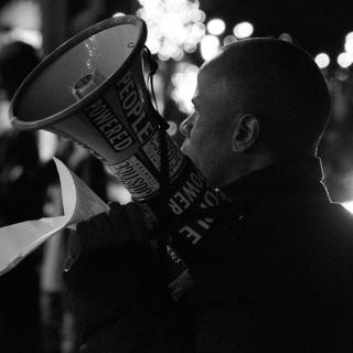 a man holding a megaphone at a Black Lives Matter protest in Memphis