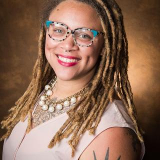 Headshot for Sara Green, youth and young adults of color ministry associate in the UUA Office of Youth and Young Adult Ministries.