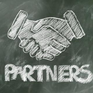 "Shaking hands, ""partners"""