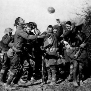SOLDIERS CELEBRATE the news of the Armistice.