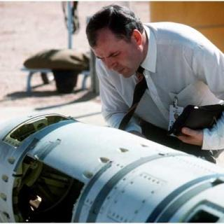 A Soviet inspector examines a BGM-109G Tomahawk ground-launched cruise missile prior to its destruction pursuant to the INF Treaty, October 18, 1988, at Davis-Monthan US Air Force Base in Arizona