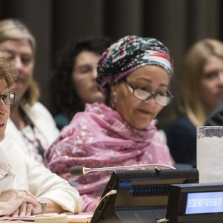 Photo of the UN Special Representative for International Migration, alongside other diplomats at the UN.