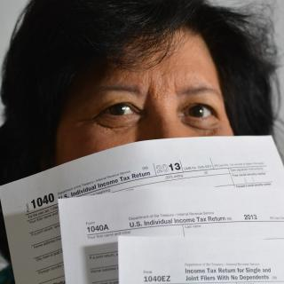 Woman holding tax return forms
