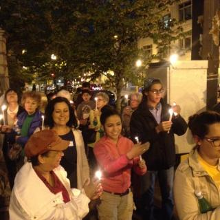 A crowd of Unitarian Universalists walks in a candlelight vigil honoring the life of Freddie Gray.
