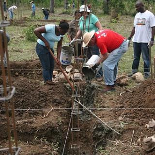 Haiti trip participants and MPP workers, laying the foundation for the eco-village.