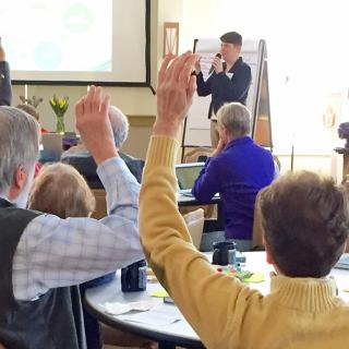 Raised hands at a workshop on worship
