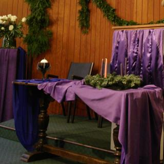 Chalice and Advent Wreath on UU chancel.