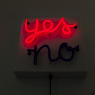 "A red neon ""yes,"" in cursive, above an unlit ""no"""