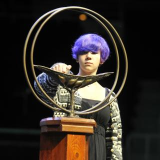 Emma Merchant lighting the chalice at General Assembly 2014