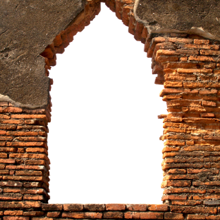 Old brick wall with window opening and cracked plaster