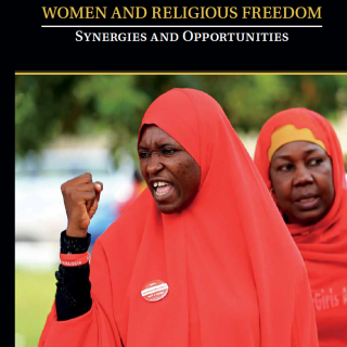 "A photo shows a member of the #BringBackOurGirls Abuja campaign group raising her fist during a protest on the cover of a report entitled ""Women and Religious Freedom: Synergies and Opportunities"""