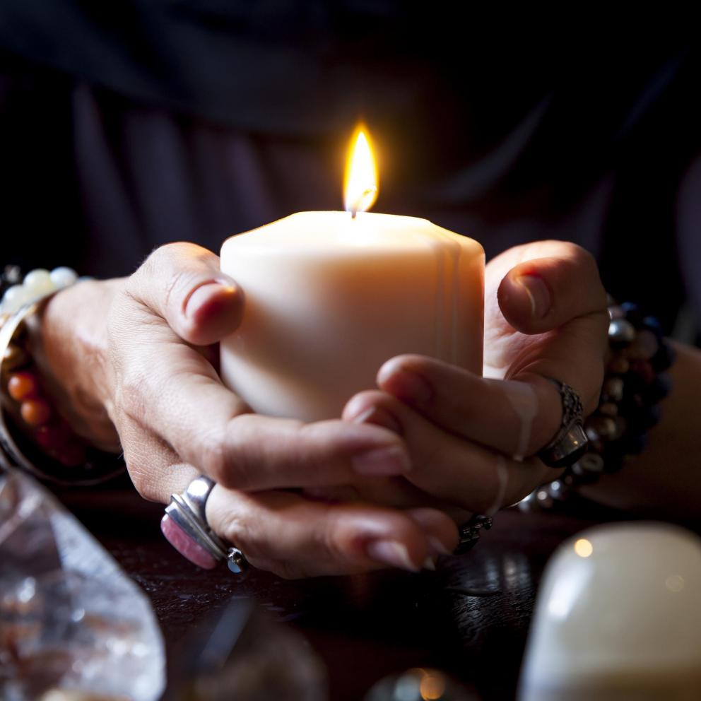 Hands holding a candle - Stock image