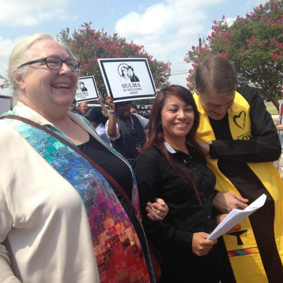 The Rev. Meg Barnhouse, Sulma Franco, the Rev. Chris Jimmerson celebrate after Franco was allowed to stay in the U.S., ending her sanctuary stay at First UU Church of Austin